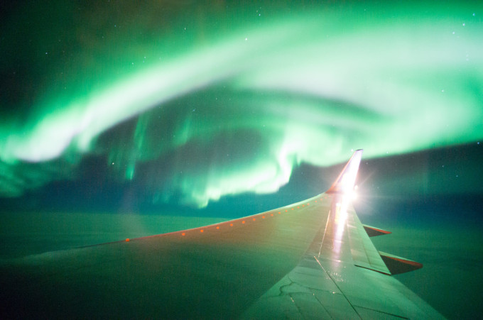Plan Flying Over Northern Lights in Iceland