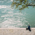 Woman Relaxing Sitting by Seine Paris